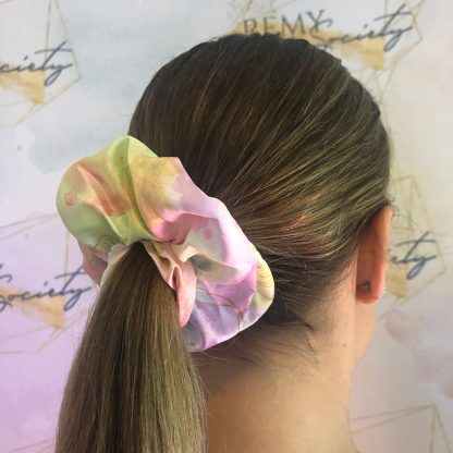 remy society scrunchie in a side ponytail hair style